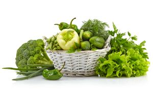 Composition of fresh green vegetables isolated on white background