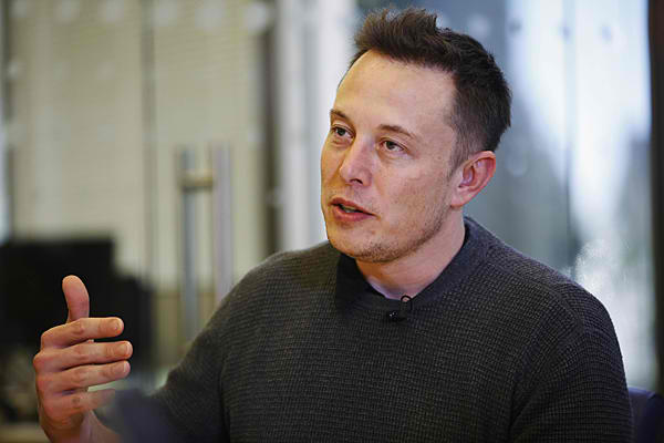 tesla-ceo-elon-musk-confirms-talks-with-apple-skips-details