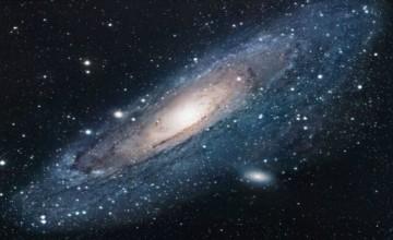 (tekst ispod slike) Patuljaste galaksije stvorile su krug i kreću se oko galaksije Andromeda u naizgled složenoj koreografiji. Ovo je prvi put da astronomi gledaju jednu takvu neobičnu strukturu; shvaćanje tog procesa moglo bi pomoći našem razumijevanju nastanka galaksija. Slika: ESA/Wikicommons