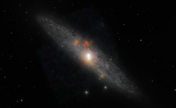 NASA composite image from NuSTAR and the European Southern Observatory in Chile shows the Sculptor galaxy