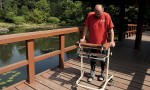 Darek Fidyka walks with the aid of leg-braces and a walking frame