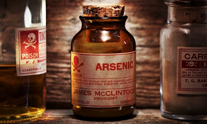 Vintage arsenic poison bottle on antique shelf